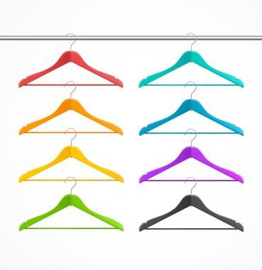 Coat hanger wood set isolated on white. Rainbow.