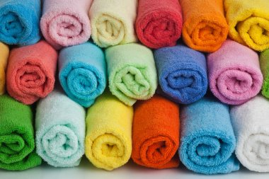 Set of colored towels on white.