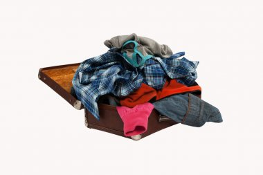 stack of clothes in opened suitcase isolated on white background