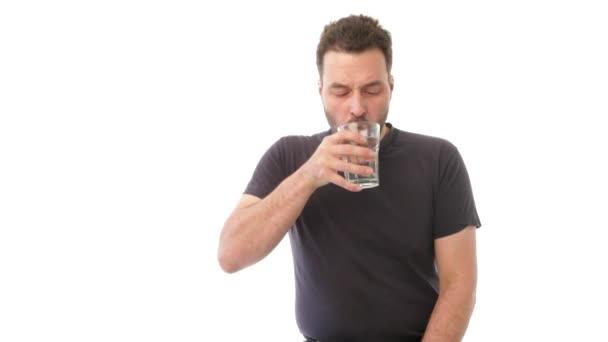12e55ad221f3 Mature man drinking glass of water — Stock Video © MichaelJayFoto ...