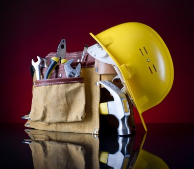 tool belt, hammer and helmet