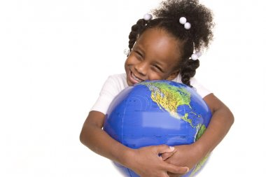 Pretty little girl hugs the globe