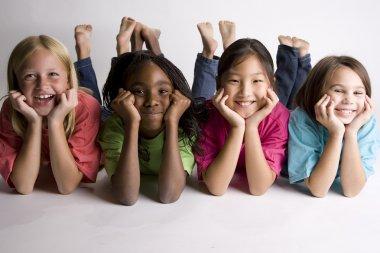 Smiling girls lying on the floor