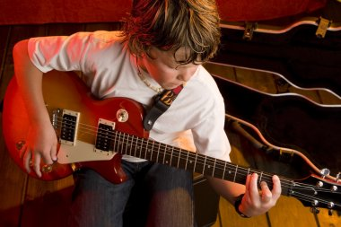 Child rock star playing electric guitar