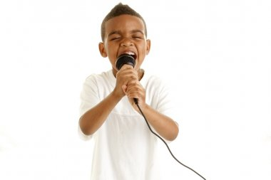 Little boy sings with microphone