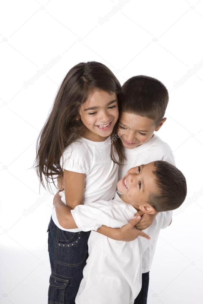 cute hispanic siblings hugging stock photo jbryson 21358043