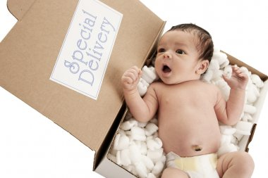 Delivery package with sleeping newborn boy