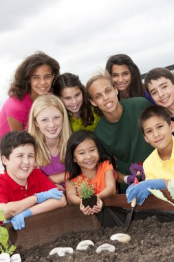 Cute ethnically diverse children working together