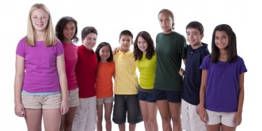 Smiling children of different ethnicities posing in colorful shirts