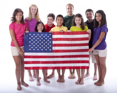 Children of different ethnicities holding an american flag