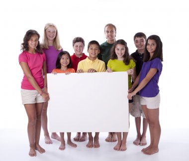 Cute children and teens holding blank sign