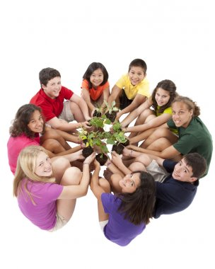 Diverse group of preteens sitting in a circle and holding plants