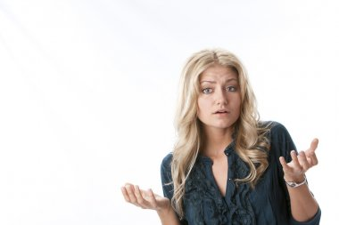 Headshot of caucasian young woman with questioning expression