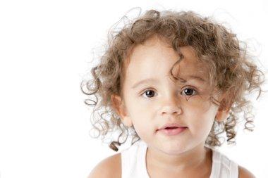 Smiling mixed race toddler girl