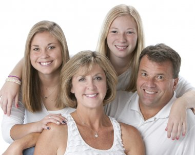 Family of four with mother, father and two daughters