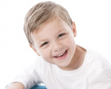Laughing caucasian little boy with brown hair