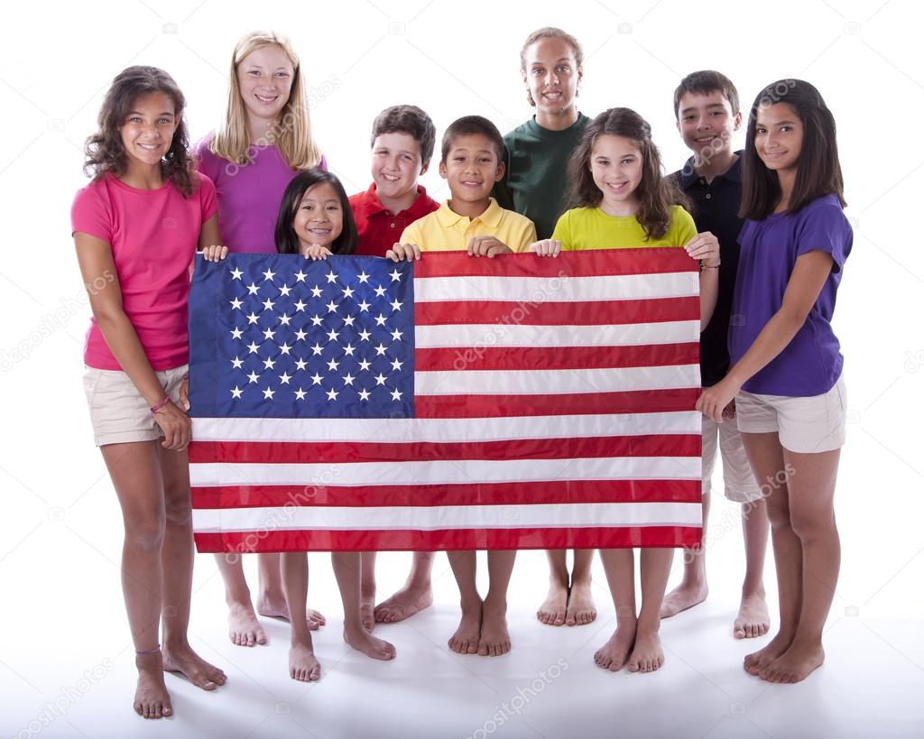 Children of different ethnicities holding an american flag ...