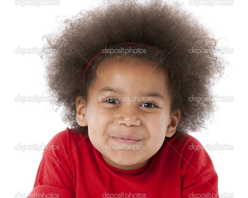 smiling ethnic little girl shrugs her shoulders stock photo