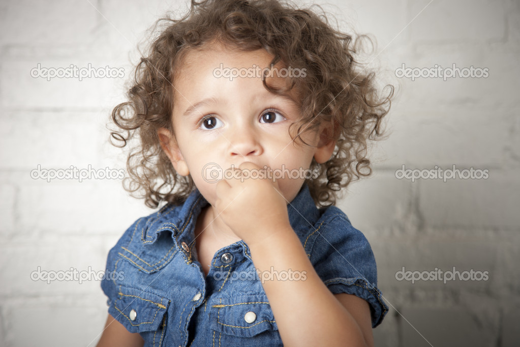 Mixed Race Toddler Girl With A Timid Expression Stock