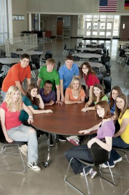 Education. Group of teenage high school students together as friends or a team, in colorful clothes