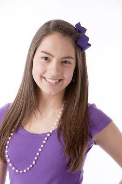 Real. Hispanic smiling real teenage girl with long, brown hair