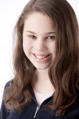 Real. Caucasian smiling little real girl with long, brown hair.