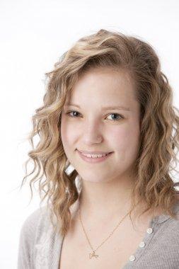 Real. Caucasian smiling teenage girl