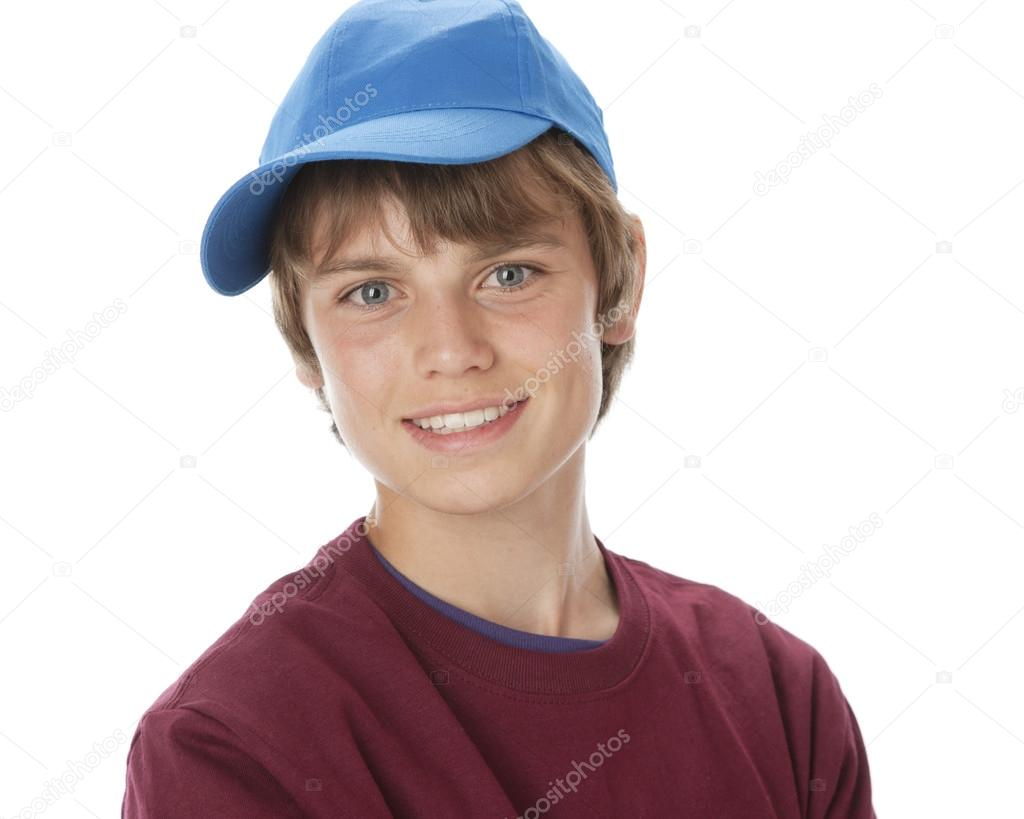 A head and shoulders image of a 14 year old caucasian real teenage boy  wearing vibrant colorful clothes and a baseball cap. — Photo by jbryson 5ae940f3a6d