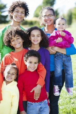 Mixed race caucasian and african american group of brothers and sisters