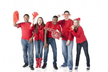 Sports Fans. Group of cheering teenagers standing together for the winning red team