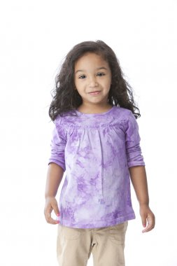 A three quarter length image of a smiling mixed race, black and caucasian, little girl with long hair and a purple shirt. stock vector