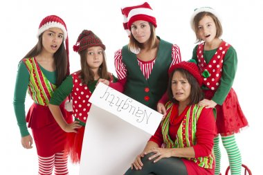 A hispanic family of christmas elves is surprised and disappointed