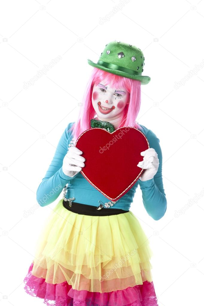 clowns young teenage female clown holding a valentine heart stock photo jbryson 21424173. Black Bedroom Furniture Sets. Home Design Ideas