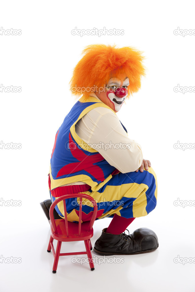 A professional male clown sits on a tiny chair u2014 Stock Photo  sc 1 st  Depositphotos & A professional male clown sits on a tiny chair u2014 Stock Photo ...