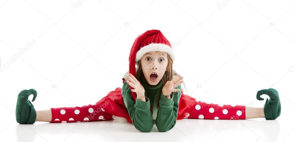 A very limber little girl Christmas elf does the splits