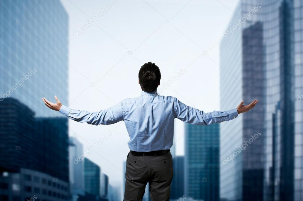 Young successful business man standing with arms wide open in front of buildings business center stock vector