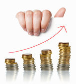 Economy positive charts: hand holding white paper with money and