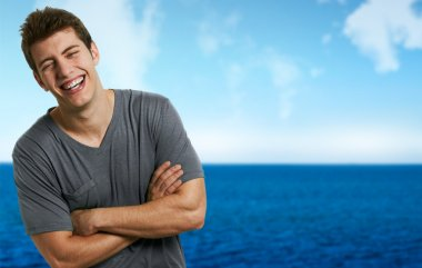 Young smiling relaxed man at the beach in a summer day stock vector