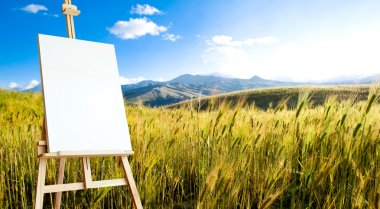 Canvas on tripod on beautiful wheat landcape at the andes mounta