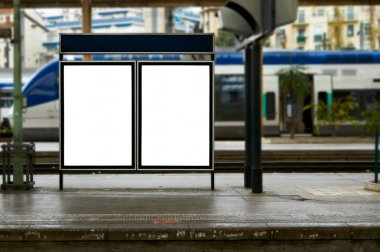 Empty blank billboard at train station