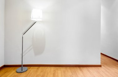 Empty wall with compy space and lamp
