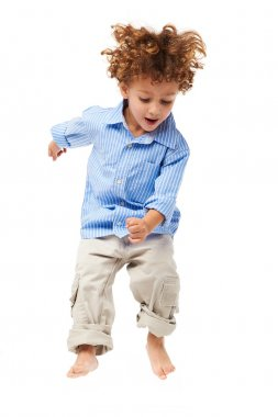 Young happy kid jumping