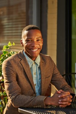 Young relaxed successful African - American business man in the