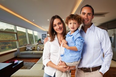 Young happy family at home: Mother, father and son