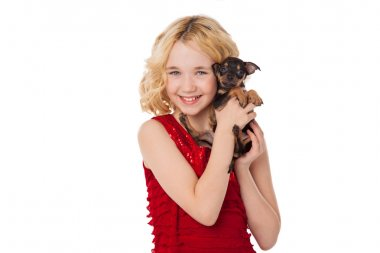 Beautiful blonde little girl holding  puppy wearing red dress stock vector