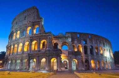 Rome's mighty Coliseum (AD 80), illuminated at night and icon of the city, still standing today as a testament to ancient engineering. stock vector