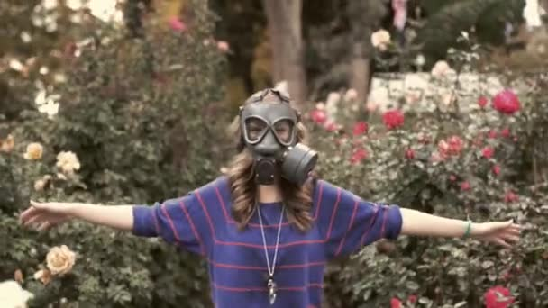 Girl in gas masks around the rose
