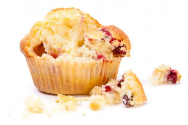 Cranberry muffin on a white background broken