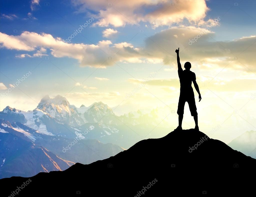 person on the peak of mountain.