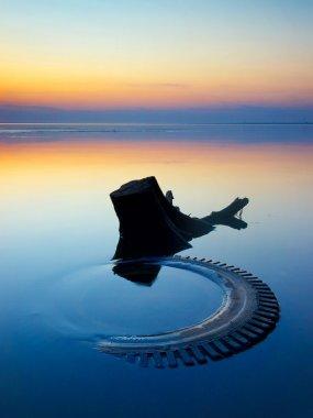 Calm water and sundown.